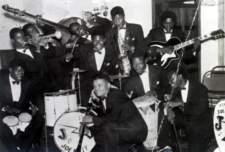 Obo Addy with the Joe Kelly Band in Ghana. They had their picture taken with an American visitor at the Accra  Club, ca. 1956, courtesy Susan Addy