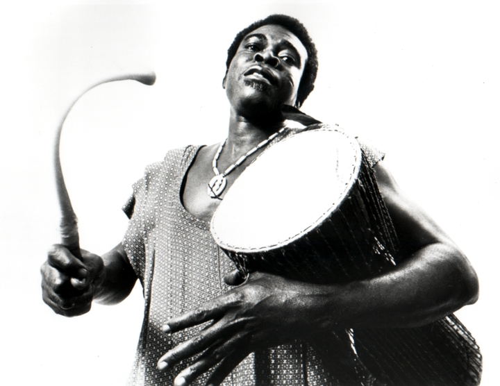 Obo Addy played a variety of drums, some strictly percussive and others, such as the one pictured here, capable of 'talking' or tonal variations. His drumming captured both the rhythmic and spiritual qualities of his homeland, Ghana. 1994, courtesy Susan Addy