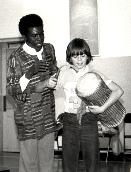 Obo Addy instructing a student on the *donno* or talking drum, 1980, Portland Oregon, courtesy Susan Addy