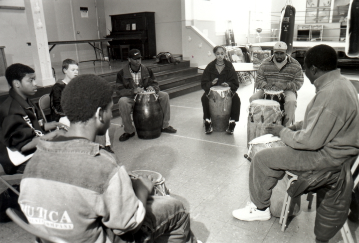 Obo Addy at the University Park Community Center teaching the basics of hand drumming to at-risk youth, Portland, Oregon, courtesy Susan Addy