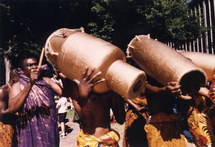 Obo Addy pouring libation at the Homowo Festival, 1997, Portland, Oregon, courtesy Susan Addy