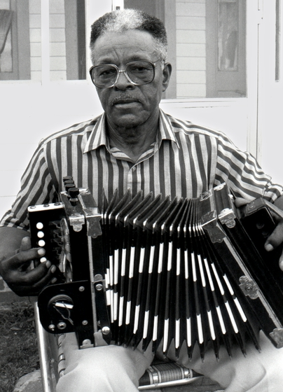 "Alphose ""Bois Sec"" Ardoin, who lived near Eunice, Louisiana, played Creole music that blended Cajun, African American and French Afro-Caribbean sounds. Eunice, Louisiana, 1990, photograph by Alan Govenar"