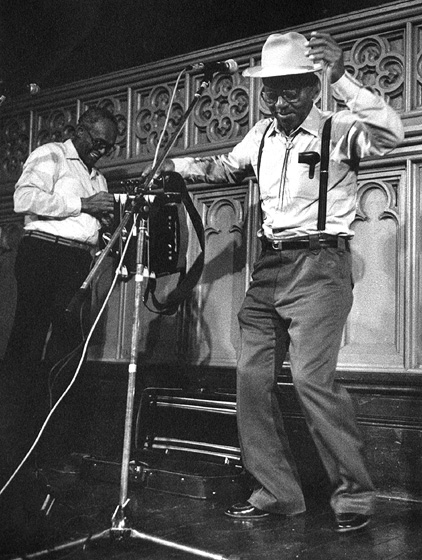 Alphonse 'Bois Sec' Ardoin dancing, Canray Fontenot in background, Washington Square Church, New York, New York, 1988, photograph by Jack Vartoogian