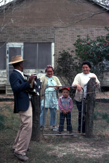 Alphonse 'Bois Sec' Ardoin peforms for neighbors on Mardi Gras day in Eunice, Louisiana, 1977, photograph by Nicholas R. Spitzer