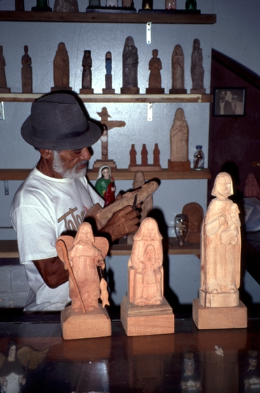 Celestino Avilés with his *santos* carvings, courtesy National Endowment for the Arts