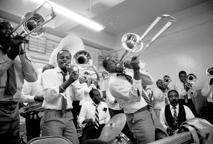 "African American ""Shout"" Band trombonist Edward Babb (front) performs at the United House of Prayer in New York City. The church's founder, ""Daddy Grace,"" drew on Scripture in emphasizing the use of wind instruments in worship. 1990, photograph by Nicholas R. Spitzer"