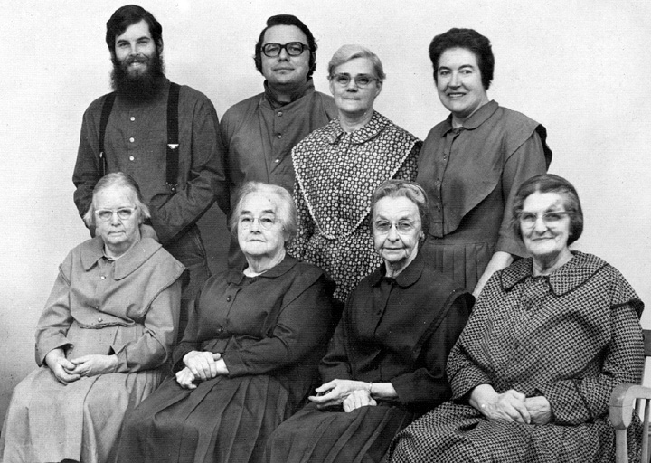 The Shaker Family at Sabbathday Lake. Seated: Sister Elizabeth Dunn, Sister Elsie McCool, Sister R. Mildred Barker, Sister Minnie Green. Standing: Brother Stepne Foster, Brother David Serette, Sister Marie Burgess, Sister Frances Carr. Ca. 1980s, courtesy United Society of Shakers, Sabbathday Lake, Maine