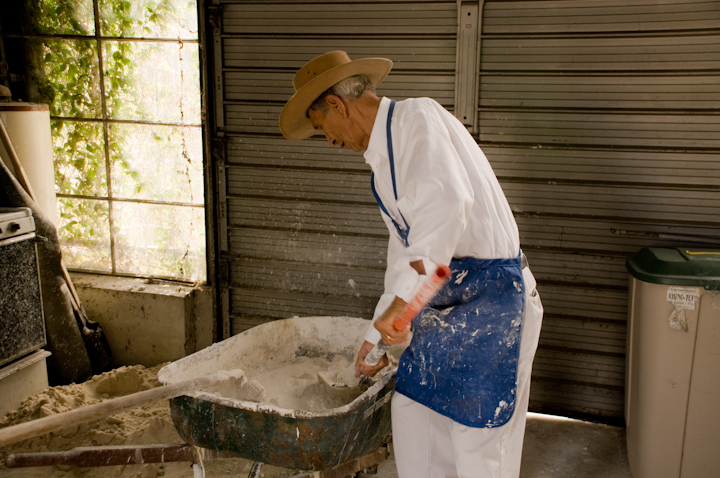 Earl Barthé mixes plaster in his studio/workshop, New Orleans, Louisiana, July 31, 2008, photograph by Alan Govenar