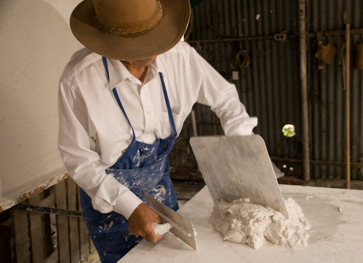 Earl Barthé prepares plaster for a mold, New Orleans, Louisiana, July 31, 2008, photograph by Alan Govenar