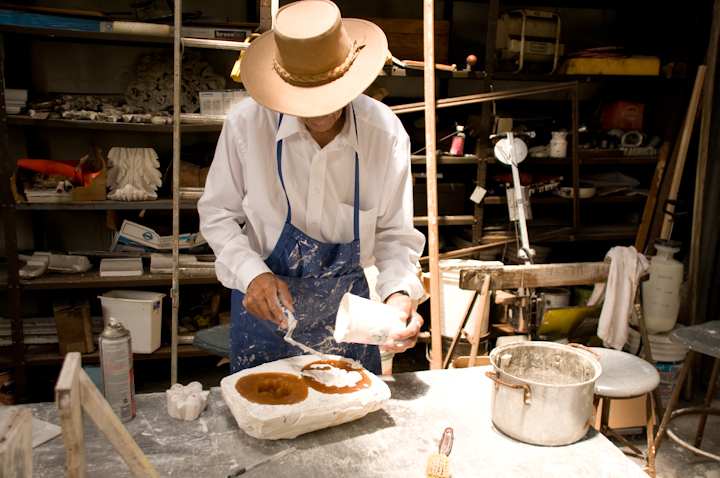 Earl Barthé pours plaster into the mold, New Orleans, Louisiana, July 31, 2008, photograph by Alan Govenar