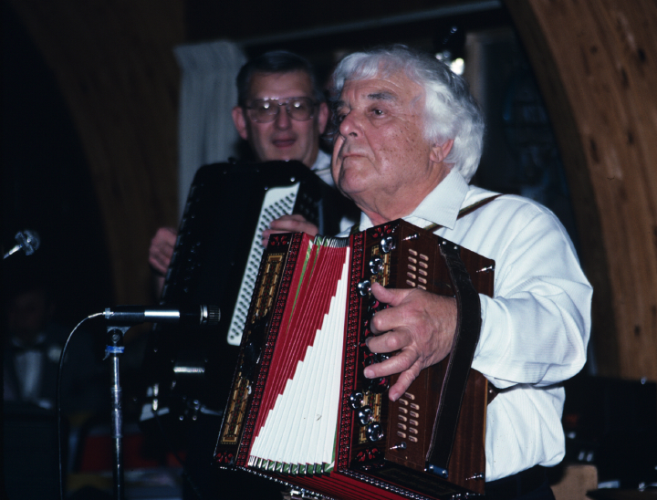 Louis Bashell plays for a fiftieth anniversary celebration at a VFW hall in Whitewater, Wisconsin. He also played at the couple's wedding and for their twenty-fifth anniversary. 1991, photograph by Alan Govenar