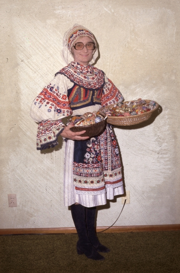 """Czech American egg decorator Kepka Belton of Wilson, Kansas, is shown in traditional dress, holding a basket of *kraslice*, or decorated eggs. """"In every Czech village, there is one woman who was the 'egg lady',"""" she said, """"and I guess around here, I'm it."""" Photograph by Jeff Burkhead, courtesy National Endowment for the Arts"""