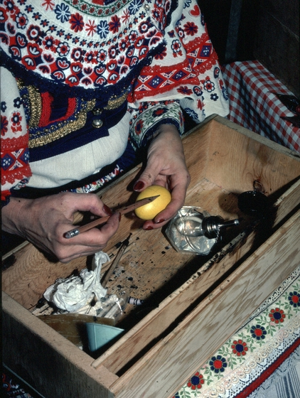 Kepka Belton, wearing traditional Czech dress and making *kraslice*, decorated eggs, courtesy National Endowment for the Arts