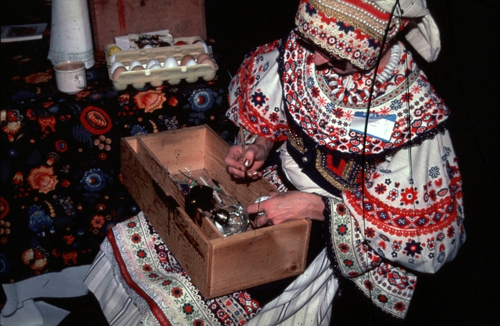 Kepka Belton, wearing traditional Czech dress and making *kraslice*, Czech decorated eggs, courtesy National Endowment for the Arts