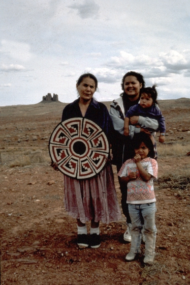 Mary Holiday Black holding one of her baskets, with her daughter, Agnes Black Grey, and her grandchildren, Navajo Reservation, Halchita, Utah, 1994, photograph by Carol Edison, courtesy Utah Arts Council