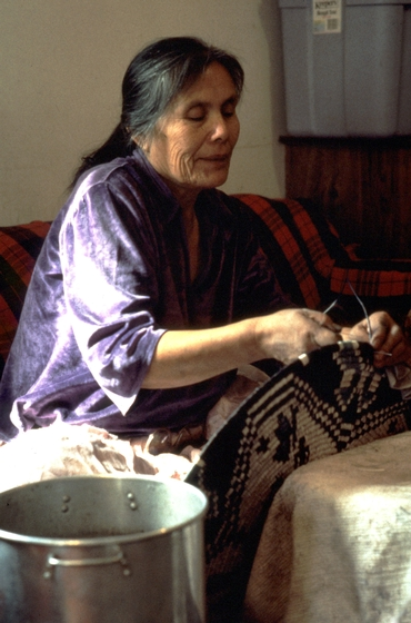 Mary Holiday Black at work in her home, Navajo Reservation, Halchita, Utah, 1994, photograph by Carol Edison, courtesy Utah Arts Council