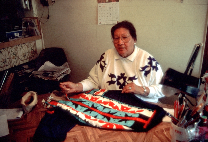 Lila Greengrass Blackdeer learned to make black ash baskets as a child to help supply her family's roadside stand. Later, she took up needlework, creating a range of items in the Hocak tradition, from moccasins to beaded hair wraps. Photograph by Lewis Kotch, courtesy National Endowment for the Arts