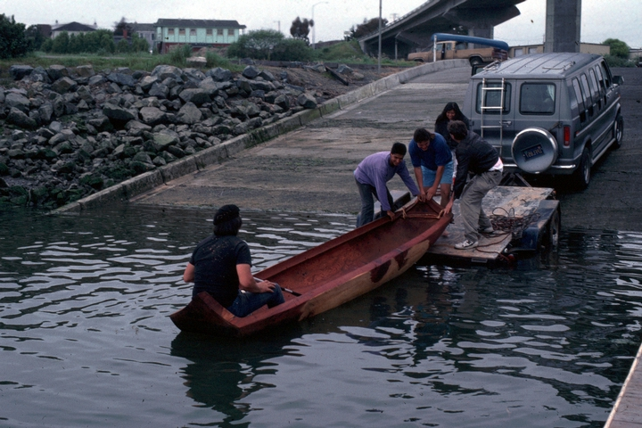 George Blake, artist in residence, Humboldt State University, launching one of his Yurok canoes, 1990, courtesy National Endowment for the Arts