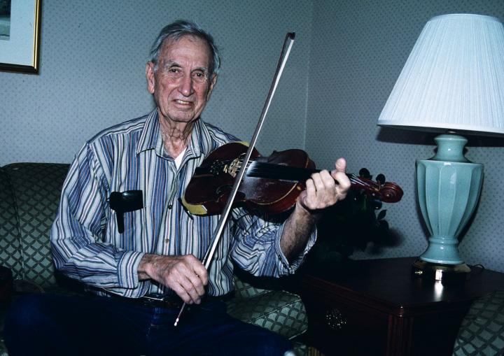 "Tennessee-born fiddler Ralph Blizard focused on traditional music in his distinctive long-bow style, but he also loved to improvise. ""You play the way you feel,"" he said. ""It's sort of inspirational when you get into it."" Arlington, Virginia, 2002, photograph by Alan Govenar"