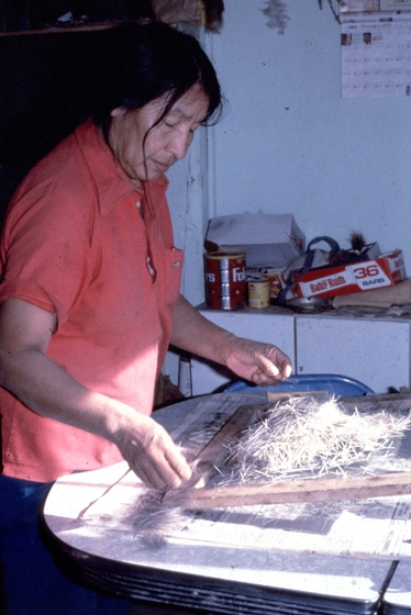 Alice New Holy Blue Legs at home cleaning the quills before dyeing them, ca. 1980, Grass Creek, South Dakota,  photograph by H. Jane Nauman, courtesy South Dakota Folk Arts Program and National Endowment for the Arts