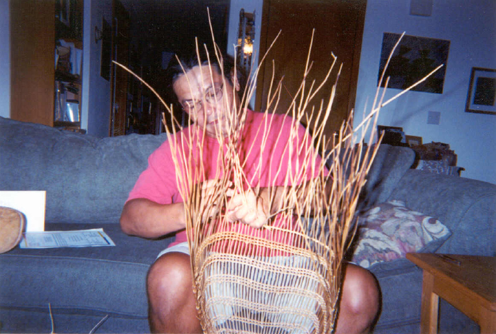 Loren Bommelyn working on a baby basket at home, courtesy Loren Bommelyn