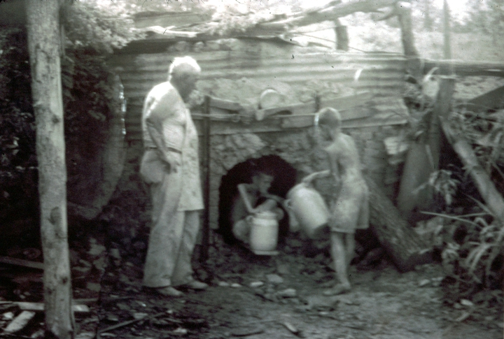 Brown Pottery with Horace Vincent Brown (Jerry's dad) and Jack and Jerry (in kiln), Sulligent, Alabama, ca. 1950, courtesy Jerry Brown