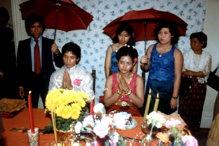 Em Bun's son, Hieng, and his bride, Yat, say 'Thank You' for a blessing on their wedding day. Harrisburg, Pennsylvania, 1985, courtesy Em Bun
