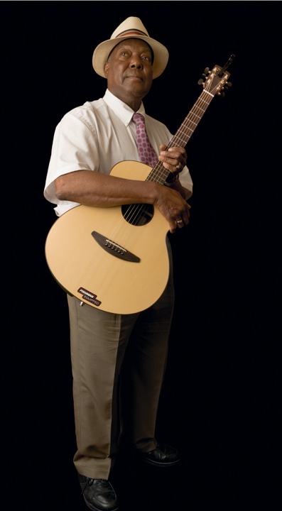 "John Cephas said of his Piedmont blues fingerpicking style, ""It's almost like the guitar is talking, mimicking your feelings or the words to the songs, and that steady accompanying bass (played with the thumb) gives it a jumping rhythm, a loping sound."" 2007, photograph by Alan Govenar"