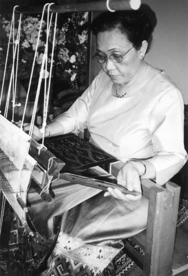 Bounxou Chanthrapone became an expert in many Laotian weaving styles before fleeing her country in the 1970s. After spending time in a refugee camp in Thailand, where she taught weaving and the Lao language, she immigrated to the United States. Living in the Minneapolis, Minnesota, area, she continued to practice and teach both weaving and silk tie-dyeing, Courtesy National Endowment for the Arts