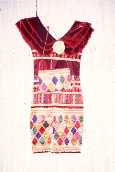 Modern evening dress with a purse by Bounxou Chanthrapone. The designs are traditional from the central and southern regions of Laos. Cotton, linen and nylon, courtesy National Endowment for the Arts