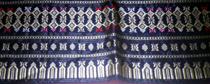 Border of a Lao skirt (detail), weaving by Bounxou Chanthrapone with traditional designs from the central region of Laos, cotton, linen and nylon, courtesy National Endowment for the Arts