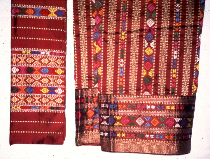 Traditional ceremonial wedding dress (detail), combination of a shawl and skirt, weaving by Bounxou Chanthrapone with traditional designs from the northern region of Laos, pure silk with gold and silk metallic threads, courtesy National Endowment for the Arts