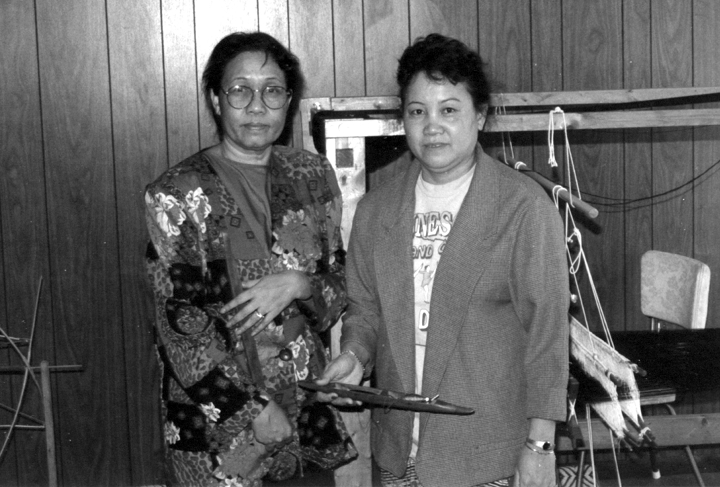 Bounxou Chanthrapone (left) with her apprentice, Anouock Omvongkot, in her living room, Brooklyn Park, Minnesota, ca. early 1990s, photograph by Phil Nusbaum, courtesy Minnesota State Arts Board