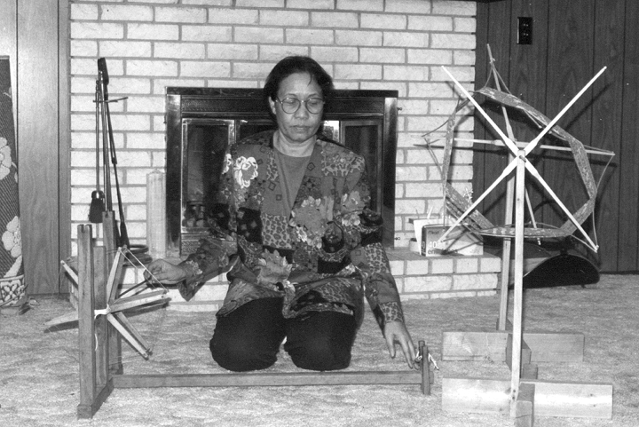 Bounxou Chanthrapone in her living room, Brooklyn Park, Minnesota, ca. early 1990s, photograph by Phil Nusbaum, courtesy Minnesota State Arts Board
