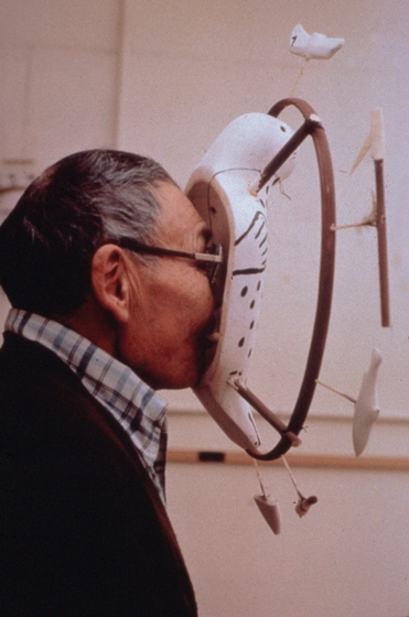 Nicholas Charles looking through a traditional Yup'ik mask, photograph by Nicholas Charles, Jr., courtesy National Endowment for the Arts