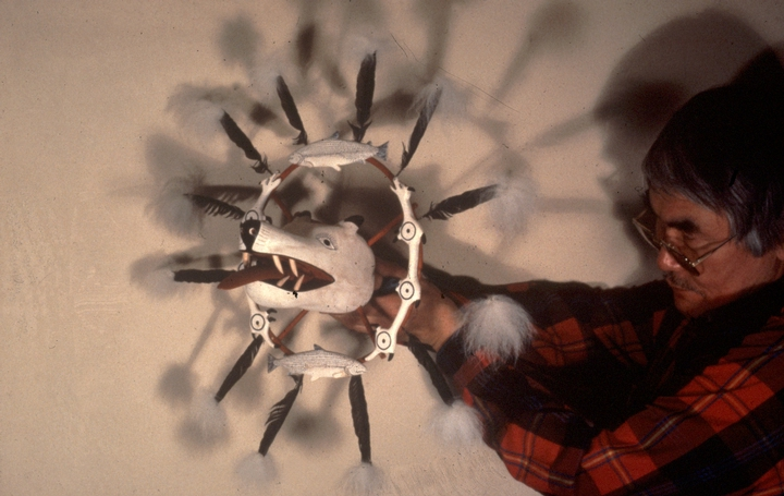 Nicholas Charles holding a traditional Yup'ik mask, photograph by Nicholas Charles, Jr., courtesy National Endowment for the Arts and Alaska State Council on the Arts