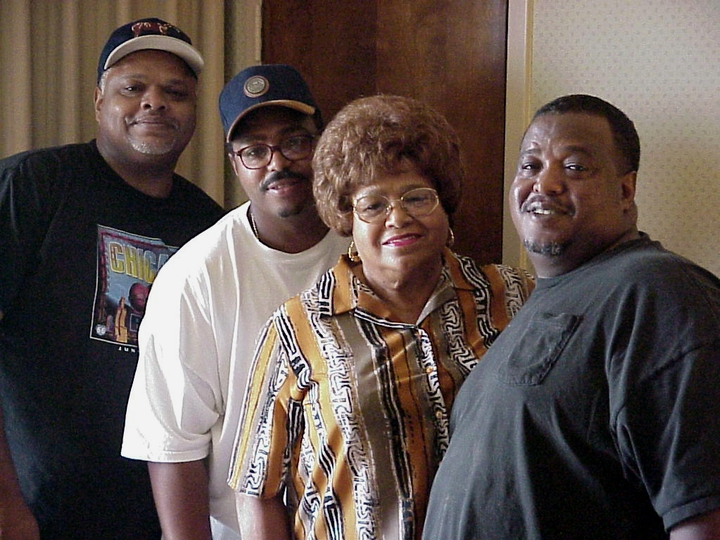 Wilson 'Poncho' Chavis, Jr., Rellis Chavis, Leona Chavis (Boozoo's widow) and Anthony Chavis, Arlington, Virginia, 2001, photograph by Alan Govenar