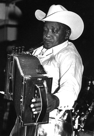 Wilson 'Boozoo' Chavis at Slim Y-Ki-Ki Club, Opelousas, Louisiana, 1989, photograph by Jack Vartoogian