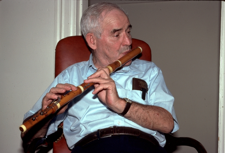 Irish immigrant Jack Coen became a mainstay of the traditional Irish music scene in New York City. To save the wooden flute from extinction, he and two carpenter friends began making their own flutes in the late 1970s.  Washington, D.C., 1991, photograph by Alan Govenar