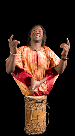 Though he lost the use of his legs to polio while growing up in Guinea, West Africa, Sidiki Conde has become an acclaimed musician and dancer who tours internationally with his Tokounou ensemble. Bethesda, Maryland, 2007, photograph by Alan Govenar