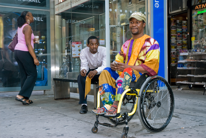 Sidiki Conde waiting for a bus on his way home from his after-school workshop, New York City, 2011, photograph by Alan Govenar