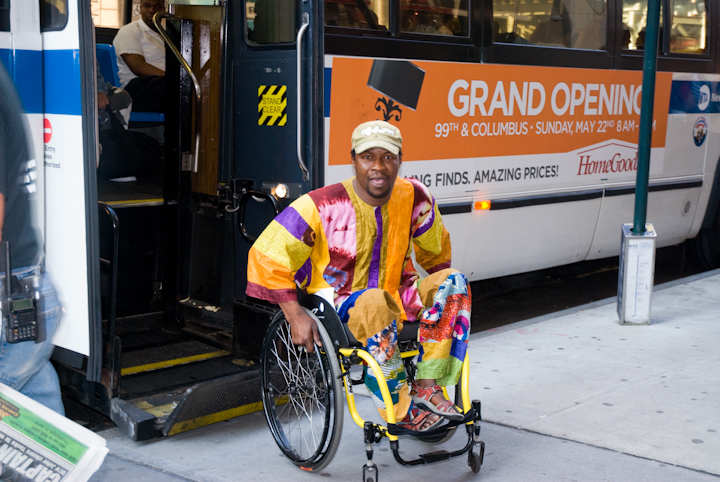 Sidiki Conde leaving the bus on his way home from his after-school workshop, New York City, 2011, photograph by Alan Govenar