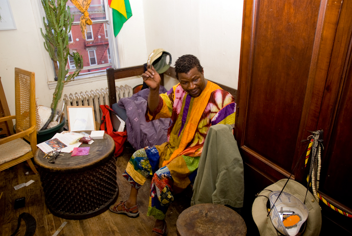 Sidiki Conde inside his apartment, New York City, 2011, photograph by Alan Govenar