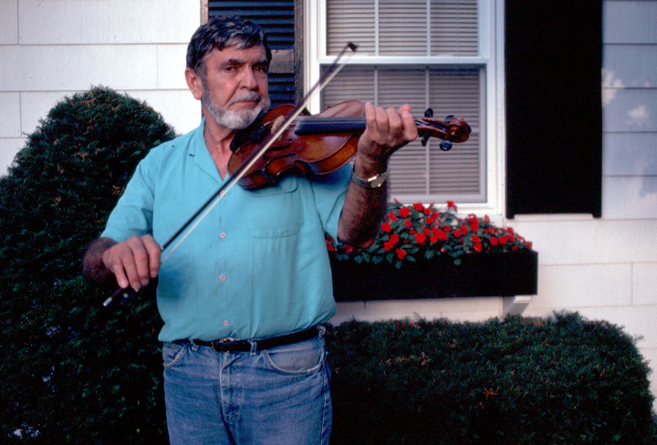 Joseph Cormier in front of his house in Waltham, Massachusetts, 1990, photograph by Alan Govenar