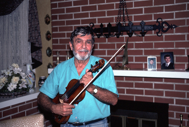 Joseph Cormier in his living room, Waltham, Massachusetts, 1990, photograph by Alan Govenar