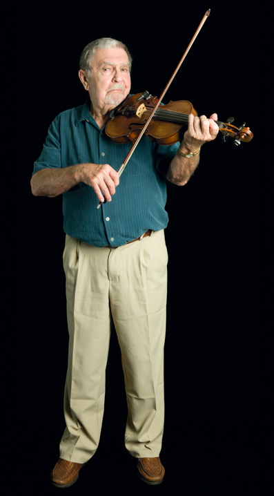 "Cape Breton fiddler Joseph Cormier emigrated in the 1960s from Canada to Waltham, Massachusetts, where he was sought out to play for weekly dances known as ""kitchen junkets."" 2007, photograph by Alan Govenar"