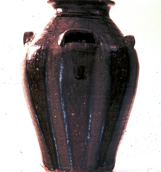 "Five-gallon jar by Burlon Craig, 19"" high, stoneware with akaline-glaze glass runs, ca. 1987, photograph by Michel Monteaux, courtesy Museum of International Folk Art (a unit of the Museum of New Mexico)"