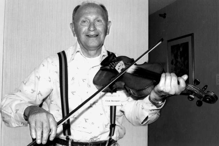 Clyde Davenport made his first fiddle from barn boards when he was 9. His musical repertoire grew to more than 200 tunes, many of which he had learned from his father, grandfather and neighbors. Washington, D.C., 1992, photograph by Alan Govenar