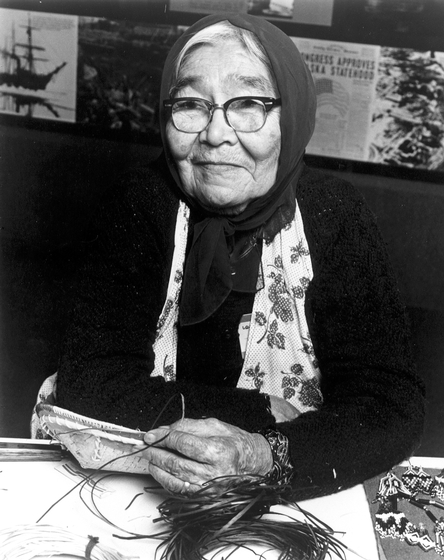 "Alaska Native Belle Deacon learned to make birch bark and root baskets from her grandmother while growing up in an Athabascan village. Throughout her life, Deacon gathered materials for her baskets. ""it's hard work,"" she said. ""You couldn't buy the roots from nobody."" Photograph by Barry McWayne, courtesy National Endowment for the Arts"