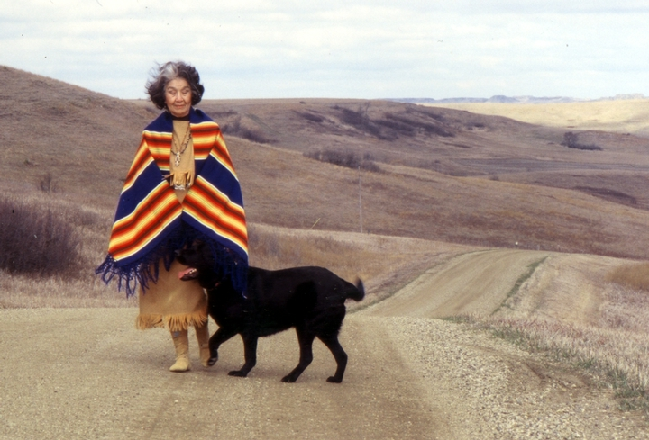 Mary Louise Defender-Wilson walking her dog, Hoksina, near her home in south central North Dakota, 2001, photograph by Dennis Gad, courtesy North Dakota Council on the Arts